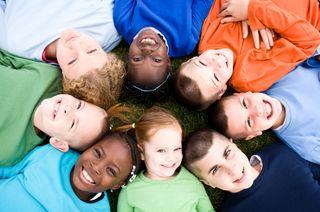 Circle of smiling kids